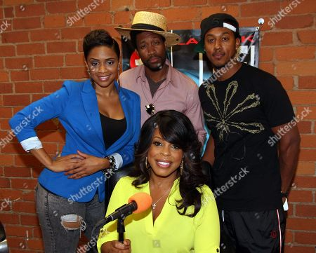 L-R) Radio personalities Staci Harris, JT Jackson, Wesley Jonathan and special guest host actress Niecy Nash (c) live on air at The Staci Harris Show at LA Talk Live, in Los Angeles, California