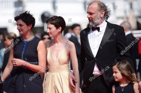 From left, director Alice Rohrwacher, Alba Rohrwacher and Sam Louwyck arrive for the screening of The Wonders (Le Meraviglie) at the 67th international film festival, Cannes, southern France