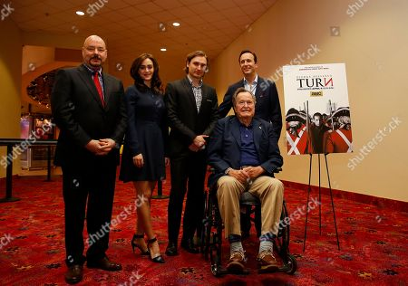 IMAGE DISTRIBUTED FOR AMC - Former President George H.W. Bush, second from the right, AMC president Charlie Collier, right, AMC head of programming Joel Stillerman, left, actress Heather Lind, second from the left, and actor Seth Numrich, center, attend a private screening of AMC's new series TURN on Saturday, March, 29, 2014 in Houston, Texas