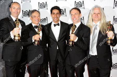 Stock Image of From left, Erik-Jan De Boer, Ang Lee, Suraj Sharma, Mychael Danna, and Claudio Miranda arrive at the Twentieth Century Fox & Fox Searchlight Pictures Oscar Party at the LURE on in Los Angeles