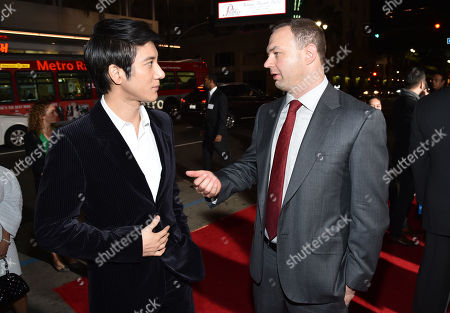 "Leehom Wang, left, and Thomas Tull arrive at the world premiere of ""Blackhat"" at the TCL Chinese Theatre, in Los Angeles"
