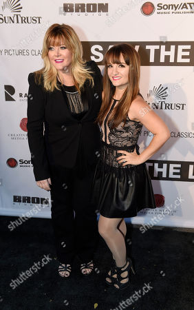 """Actress Charlene Tilton, left, with country music artist Jamie O'Neal attends the premiere of """"I Saw The Light"""", in Nashville, Tenn"""