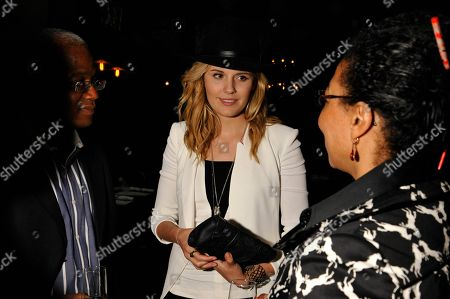 """Stock Photo of Actress Maggie Grace speaks with guests at the """"We'll Never Have Paris"""" SxSw cast dinner at Supper Suite By STK hosted by Blue Moon Brewing Co.,, in Austin, Texas"""