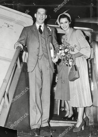 Picture Shows The 7th Earl Of Harewood And Fiancee Marion Stein. She Became His Wife Countess Of Harewood On 29/9/1949 They Divorced In April 1967. (married Jeremy Thorpe 3/1973) They Are Pictured Leaving For Their Honeymoon. He Is A Cousin Of The Queen His Mother Was Mary The Princess Royal. (filed In Main Library Lp-3f)