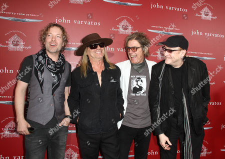 Daxx Nielsen, from left, Robin Zander, Tom Petersson and Rick Nielsen of Cheap Trick arrive at the 13th annual Stuart House benefit at John Varvatos Boutique, in West Hollywood, Calif