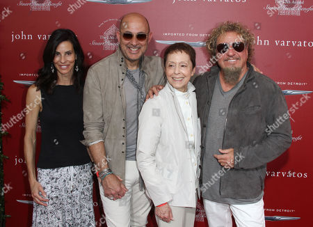 Thea Varvatos, from left, John Varvatos, Gail Abarbanel and Sammy Hagar arrive at the 13th annual Stuart House benefit at John Varvatos Boutique, in West Hollywood, Calif