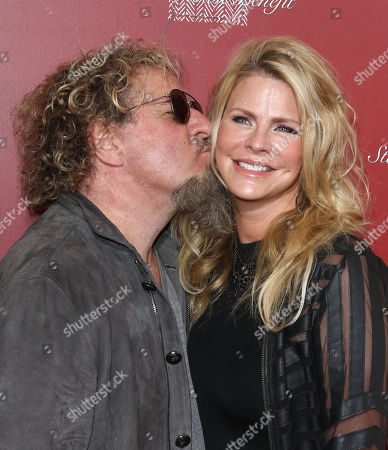 Sammy Hagar, Left, and Kari Karte arrive at the 13th annual Stuart House benefit at John Varvatos Boutique, in West Hollywood, Calif