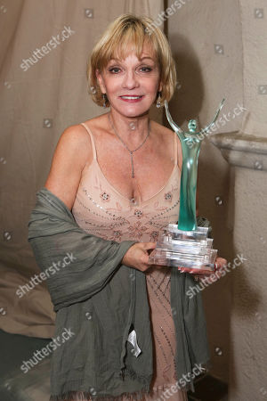 "Cathy Rigby poses with the ""Best Season"" award for the La Mirada Theatre for the Performing Arts during the 24th Annual LA Stage Alliance Ovation Awards held at the San Gabriel Mission Playhouse, in San Gabriel, Calif"
