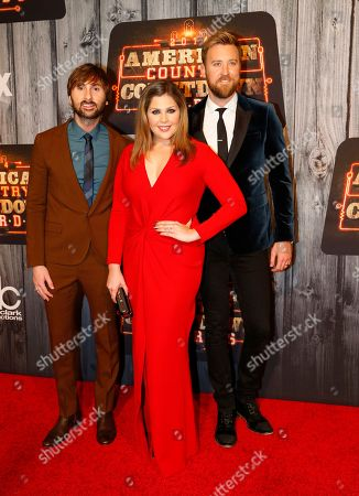 Country Group Lady Antebellum, from left, Dave Haywood, Hilary Scott and Charles Kelley, pose at the 2014 American Country Countdown Awards Red Carpet at the Music City Center on in Nashville, Tenn