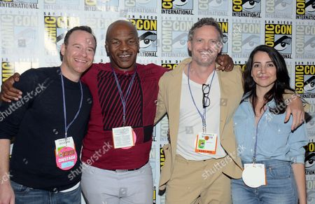 """Larry Dorf, from left, Mike Tyson, Hugh Davidson and Rachel Ramras attends the """"Mike Tyson Mysteries"""" press line on day 2 of Comic-Con International, in San Diego, Calif"""