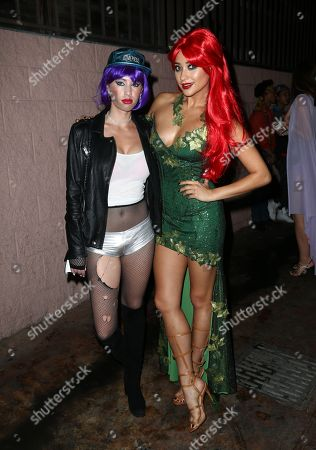 Dylan Frances Penn, left, and Shay Mitchell attends the 2015 Just Jared Halloween Party at No Vacancy, in Hollywood, Calif