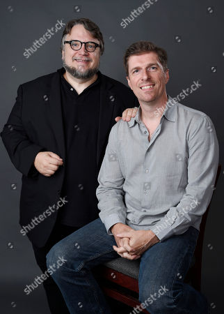 "Guillermo del Toro, left, and Chuck Hogan, co-creators of the FX series ""The Strain,"" pose together for a portrait during the 2015 Television Critics Association Summer Press Tour at the Beverly Hilton, in Beverly Hills, Calif"