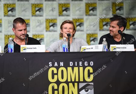 """George Eads, from left, Lucas Till, and executive producer Peter Lenkov attend the """"MacGyver"""" panel on day 1 of Comic-Con International, in San Diego"""