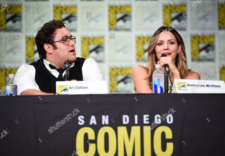 "Ari Stidham, left, and Katharine McPhee, attend the ""Scorpion"" panel on day 1 of Comic-Con International, in San Diego"
