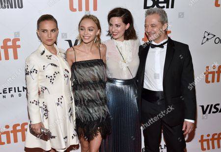 Natalie Portman, from left, Lily-Rose Depp, director Rebecca Zlotowski and Emmanuel Salinger arrive at the Planetarium premiere on day 3 of the Toronto International Film Festival at Roy Thomson Hall, in Toronto