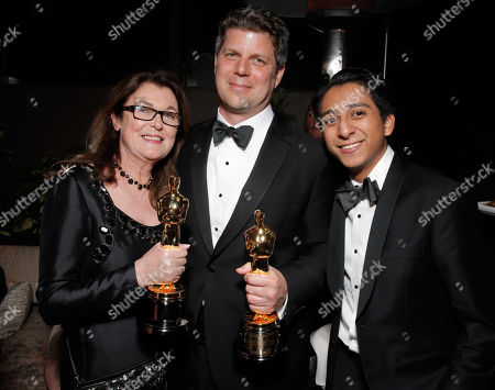 "Frances Hannon, from left, Adam Stockhausen, and Tony Revolori with their award for best production design for ""The Grand Budapest Hotel"" sseen at the 20th Century Fox & Fox Searchlight Oscar Party at BOA Steakhouse, in West Hollywood, Calif"