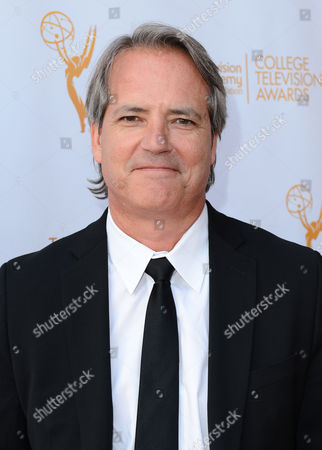 Graham Yost poses on the red carpet at the 35th College Television Awards, presented by the Television Academy Foundation at The Leonard H. Goldenson Theatre in the NoHo Arts District, in Los Angeles