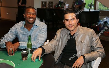 From left, Roger Cross and Actor Eddie Matos play poker at the 3rd Annual Variety - The Children's Charity of Southern California Texas Hold 'Em Poker Tournament held at Paramount Studios, in Hollywood, California