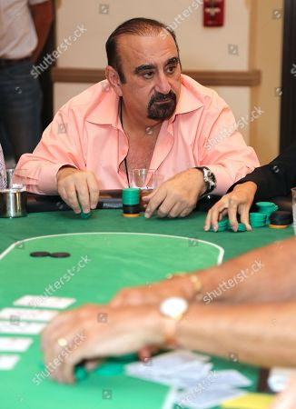 Actor Ken Davitian plays poker during the 3rd Annual Variety - The Children's Charity of Southern California Texas Hold 'Em Poker Tournament held at Paramount Studios, in Hollywood, California