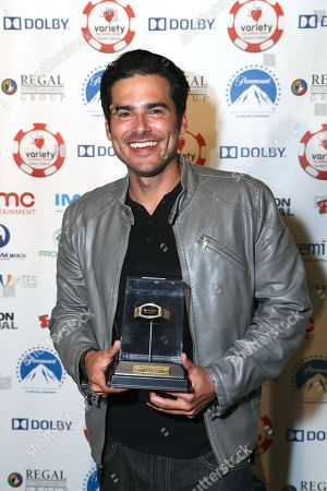 Actor Eddie Matos, the high stakes winner poses during the 3rd Annual Variety - The Children's Charity of Southern California Texas Hold 'Em Poker Tournament held at Paramount Studios, in Hollywood, California