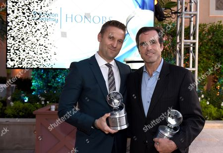 "Andy Tennant, left, and Bob Woodruff pose with the Television Academy Honors award for ""E:60 Dream On: Stories of Boston's Strongest."" at the 8th annual Television Academy Honors at the Montage hotel, in Beverly Hills, Calif"