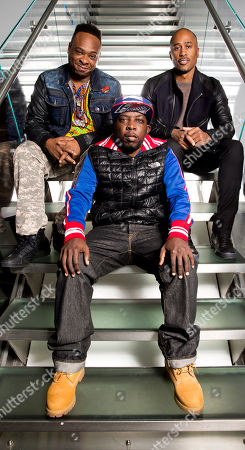 """Rapper Jarobi White, from left, Phife Dawg (Malik Isaac Taylor), and DJ/Producer Ali Shaheed Muhammad of the hip-hop group A Tribe Called Quest pose for a photo at SiriusXM studios in New York. A Tribe Called Quest celebrated the 25th anniversary of its debut album, """"People's Instinctive Travels and the Paths of Rhythm,"""" in November by re-releasing the album with remixes helmed by Pharrell, CeeLo Green and J. Cole. The group said more re-releases will be issues for its other albums"""