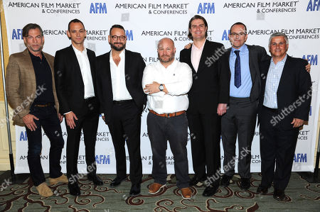 Stock Photo of Paul Steinke, SVP Production Finance, Walt Disney Studios, from left, Micah Green, Co-Head, Film Finance, CAA, Joseph Chianese, EVP,Entertainment Partners, Gareth Unwin, CEO & Founder,Bedlam Productions, Chris Spicer, Counsel,Akin Gump Strauss Hauer & Feld LLP, Brian O'shea, CEO, The Exchange, and Adrian Ward, SVP, Entertainment Industries Division,Pacific Mercantile Bank attend the American Film Market (AFM) conferences held at the Fairmont Hotel, in Santa Monica, Calif