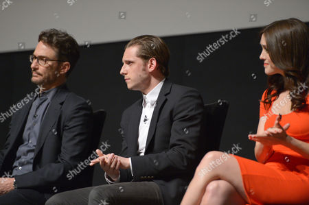 Executive producer Barry Josephson, and from left, Jamie Bell and Heather Lind speak on stage at AMC's TURN panel at the Academy of Television Arts & Sciences, in North Hollywood, Calif