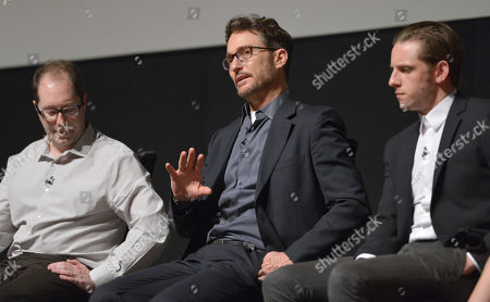 Executive producers, Craig Silverstein, and from left, Barry Josephson and Jamie Bell speak on stage at AMC's TURN panel at the Academy of Television Arts & Sciences, in North Hollywood, Calif
