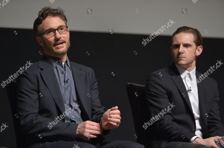 Barry Josephson, executive producer, left, and Jamie Bell speak on stage at AMC's TURN panel at the Academy of Television Arts & Sciences, in North Hollywood, Calif