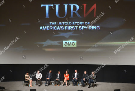 Moderator Stacey Wilson Hunt, and from left, executive producer, Craig Silverstein, executive producer Barry Josephson, Jamie Bell, Heather Lind, Seth Numrich, Burn Gorman and JJ Feild speak on stage at AMC's TURN panel at the Academy of Television Arts & Sciences, in North Hollywood, Calif