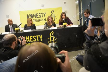 Executive Director of Amnesty USA Steven Hawkins, Board Chair Ann Burroughs, Maria Alekhina and Nadezhda Tolokonnikova participates in an Amnesty International Pussy Riot press conference on in New York