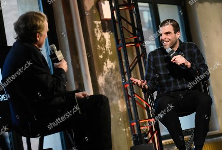 """Actor Zachary Quinto, right, chats with moderator Peter Travers during AOL's BUILD Speaker Series to discuss his new television show """"The Slap,""""at AOL Studios, in New York"""