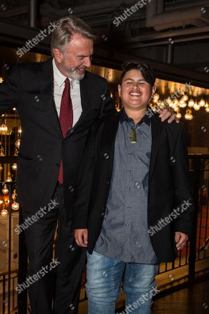 Actors Sam Neill, left, and Julian Dennison pose for photographers upon arrival at the premiere of the film 'Hunt For The Wilderpeople' in London
