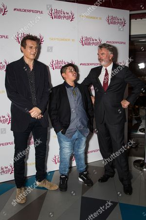 Actors Liam Neeson, from left, Julian Dennison and Sam Neill pose for photographers upon arrival at the premiere of the film 'Hunt For The Wilderpeople' in London