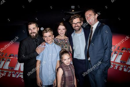 From left, director Robert Eggers, Harvey Scrimshaw, Anya Taylor-Joy, Ellie Grainger, producer Jay Van Hoy and Ralph Ineson pose for photographers upon arrival at the premiere of the film The Witch in London