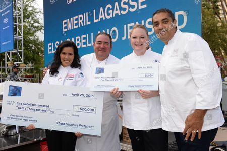 Culinary students Elsa Sabellano Jenstad, left, and Krista Burdick, pose with chefs Emeril Lagasse, left, and Michael Mina at the Chase Sapphire Preferred Grill Challenge at Emeril's New Orleans Seafood Extravaganza during Vegas Uncork'd by Bon Appetit, at MGM Grand on in Las Vegas