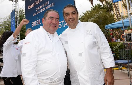 Celebrity Chefs Emeril Lagasse, left, and Michael Mina pose together after the Chase Sapphire Preferred Grill Challenge at Emeril's New Orleans Seafood Extravaganza during Vegas Uncork'd by Bon Appetit, at MGM Grand on in Las Vegas