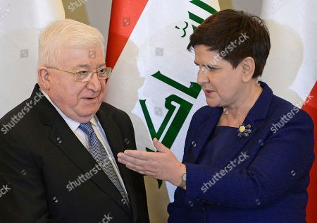 Fuad Masum, Beata Szydlo. Polish Prime Minister Beata Szydlo, right, gestures, as she walks for talks with Iraqi President Fuad Masum, in Warsaw, Poland