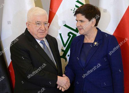 Fuad Masum, Beata Szydlo. Iraqi President Fuad Masum, left, and Polish Prime Minister Beata Szydlo shake hands prior to talks, in Warsaw, Poland