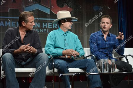 """Stock Image of From left, Walt Willey, executive producer Bob Boze Bell, and Castle Pictures Inc. president and creative director Chris Cassel speak onstage during the """"Gunsligners"""" Portion of the Discovery 2014 Summer TCA, in Beverly Hills, Calif"""