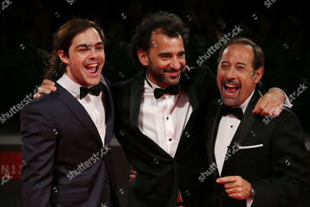 Peter Lanzani, Pablo Trapero and Guillermo Francella pose for photographers at the red carpet for the film El Clan during the 72nd edition of the Venice Film Festival in Venice, Italy, . The 72nd edition of the festival runs until Sept. 12