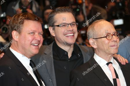 From left, actors Justus von Dohnanyi, Matt Damon and Bob Balaban arrive on the red carpet for the film The Monuments Men during the 64th Berlinale International Film Festival, in Berlin
