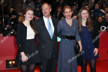 US ambassador to Germany John B. Emerson, second from left, and wife Kimberly Marteau Emerson, third from left and daughters arrive on the red carpet for the film The Monuments Men during the 64th Berlinale International Film Festival, in Berlin