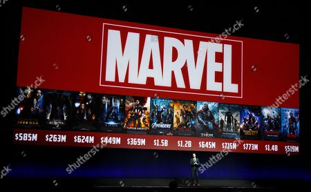"""Dave Hollis, executive vice president of theatrical distribution for Walt Disney Studios Motion Pictures, discusses the studio's Marvel brand of films during their presentation at CinemaCon 2016, the official convention of the National Association of Theatre Owners (NATO), at Caesars Palace in Las Vegas. Disney announced plans, to shut down the """"Marvel: Avengers Alliance"""" online game series at the end of the month"""