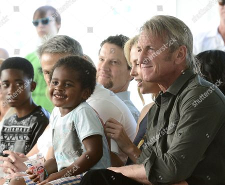 Jackson Theron, and actor Sean Penn attend the generationOn block party at Fox Studios in Los Angeles on