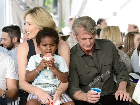 From left to right, Jackson Theron, actress Charlize Theron, and actor Sean Penn attend the generationOn block party at Fox Studios in Los Angeles on