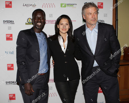 From left, Hope North founder, Okello Sam, Hilaria Baldwin and Alec Baldwin attend the Hope North Gala, on Wednesday, September, 18, 2013 in New York