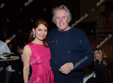 "Stock Image of Jean Shafiroff and Gary Busey pose at private LA dinner for ""Song One"" screening hosted by Jean Shafiroff with director Kate Barker-Froyland and Anne Hathaway at The Palm Restaurant, in Beverly Hills, California"