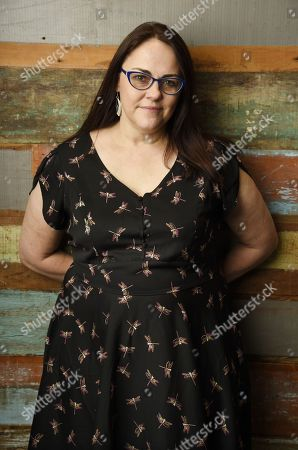 "Stock Image of Jocelyn Moorhouse, director and co-writer of the film ""The Dressmaker,"" poses for a portrait at Broad Green Pictures in Los Angeles"